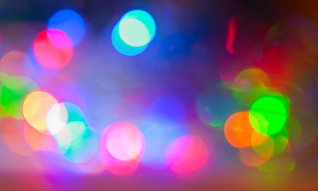 scenic spots: Bright multicolored glare on a dark background, bokeh effect
