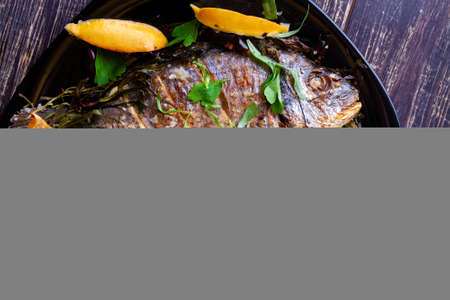 Fried gilthead with juicy fresh lemon and rice garnish and tomatoes close-up Stok Fotoğraf