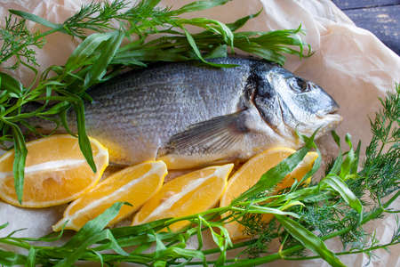 Diet gilthead fish prepared for roasting with lemon and herbs