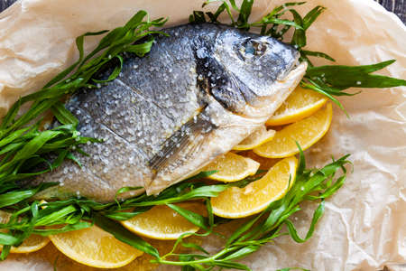 Diet sea dorado fish prepared for baking with lemon and herbs