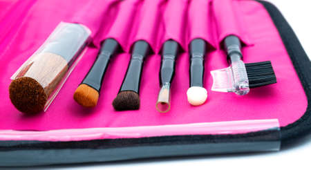 A set of professional tools for face makeup in a pink case. Stok Fotoğraf