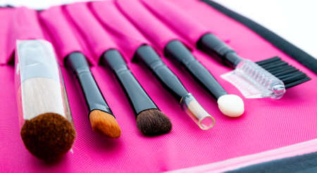 A set of professional tools for face makeup in a bright pink case Stok Fotoğraf