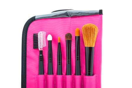 A set of professional tools for face makeup in a bright pink case. Top view