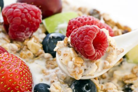 Muesli with fresh Fruits on Spoon Stock Photo - 5097667