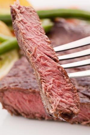 beefsteak: Beefsteak on Fork Stock Photo