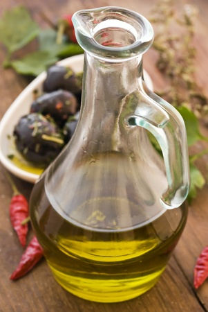 Olive Oil with black Olives photo