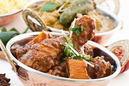 beine spreizen: Huhn Vindaloo und Curry Lizenzfreie Bilder