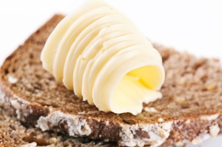 marge: Piece of bread with butter Stock Photo