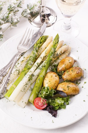 Asparagus with jacket potato photo