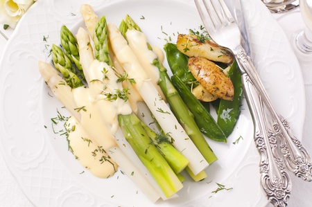 Asparagus with potato and sauce hollandaise photo