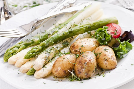 Asparagus with jacket potato and dill sauce photo