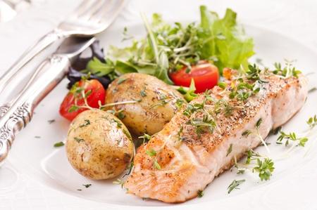 jacket potato: Salmon steak roasted with jacket potato Stock Photo