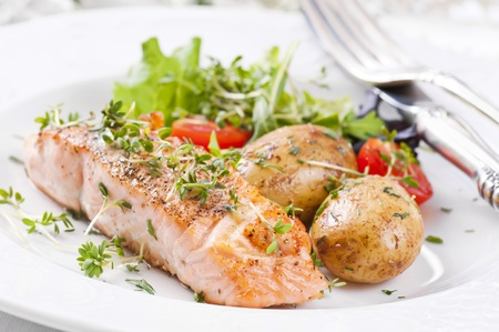 salmon steak with potato and salad