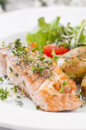 grilled fish: Salmon steak roasted with Salad and potato