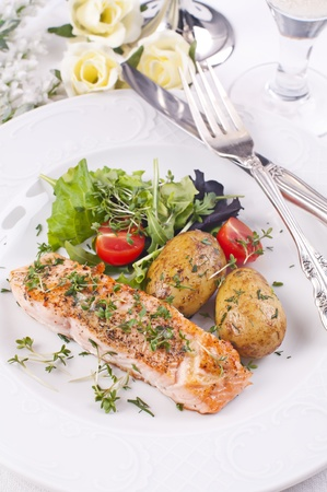 roquette: salmon steak with packet potato and salad