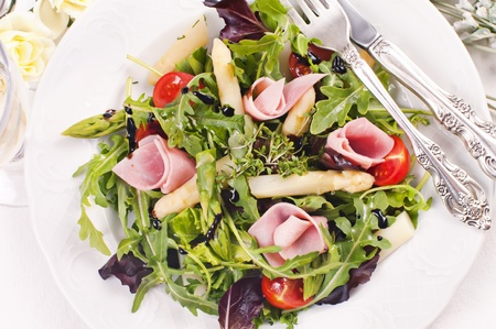 Rocket salad with boiled ham and asparagus 스톡 콘텐츠