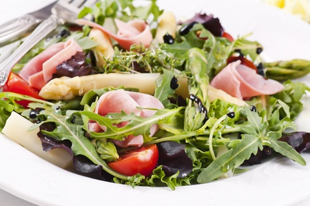 Rocket salad with ham and asparagus 스톡 콘텐츠