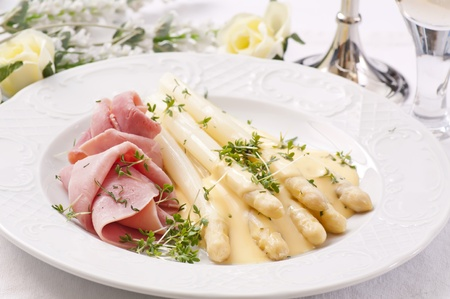 Asparagus with ham and butter sauce photo
