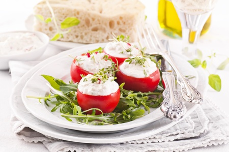 Tapas tomatos filled with ricotta photo