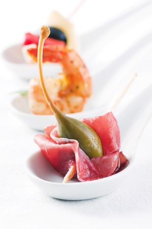 tapas: Cocktail party canapes on white background