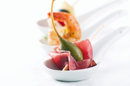 canape: Canapes on the porcelain spoon
