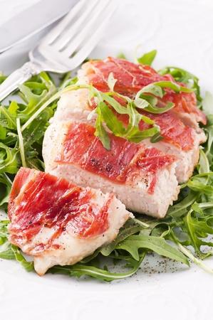 Prosciutto Chicken steak with rocket salad photo