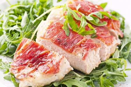Prosciutto chicken steak with rocket salad