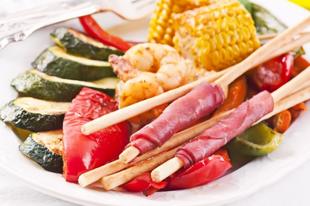 Tapas with grissini and grilled vegetables photo