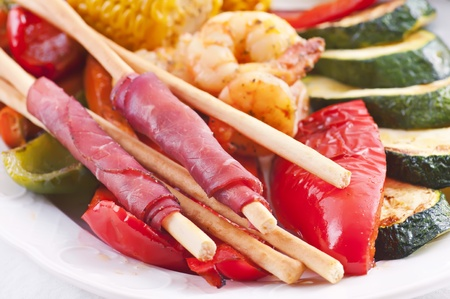 Tapas with grissini and ham and grilled vegetables  photo