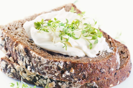ricotta cheese: Bread with fresh cheese and cress Stock Photo