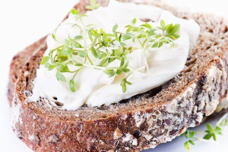 ricotta cheese: Piece of bread with fresh curd and cress Stock Photo