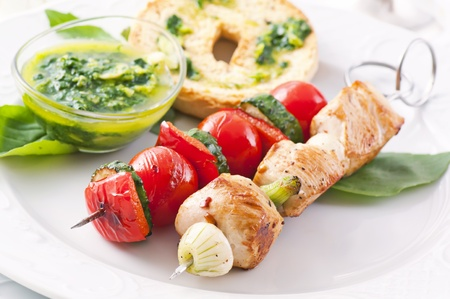 Grilled chicken and vegetable skewer with pesto
