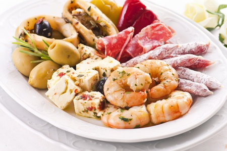 Antipasti with seafood and feta cheese photo