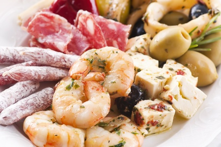Antipasto with seafood and dry sausages photo