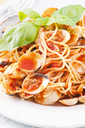 Spaghetti vongole with tomato sauce  photo