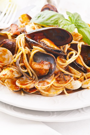 Spaghetti with mussels in tomato sauce  photo