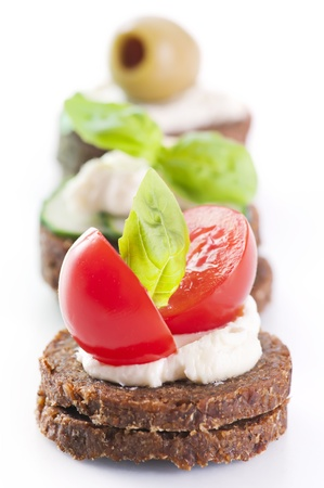 canapes: Canapes with tomato and olives