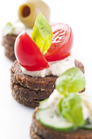 spanish tapas: Canapes with tomato and feta  Stock Photo