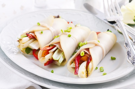 Tapas with cheese rolls filled with vegetables photo
