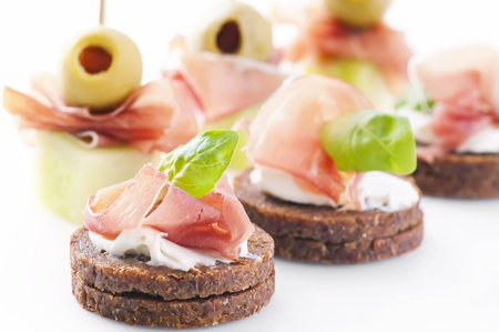 spanish tapas: canapes with ham and pickled olives Stock Photo