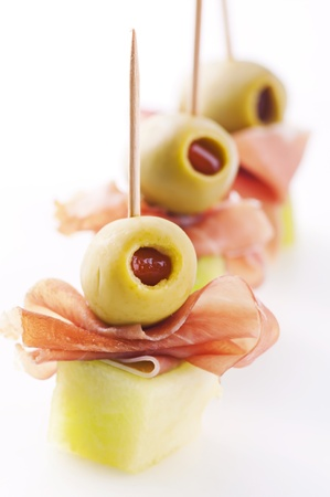 spanish food: canapes with ham and pickled olives Stock Photo