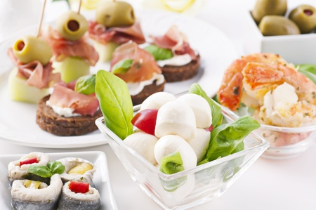 spanish tapas with caprese, canapes and seafood photo