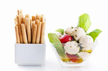grissini: snack with grissini and tomato mozzarella