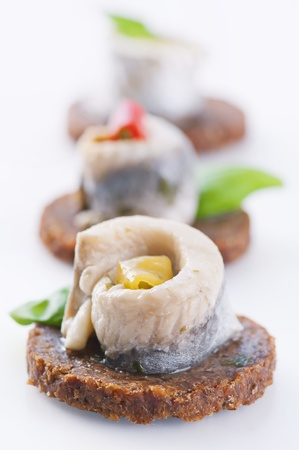 pickled: Canapes with pickled anchovy filet
