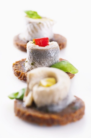 Canapes with pickled anchovy filet photo