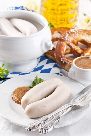 Oktoberfest breakfast with white sausages and pretzel photo