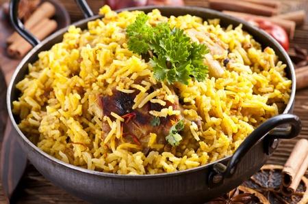 Chicken Biryani in small wok photo