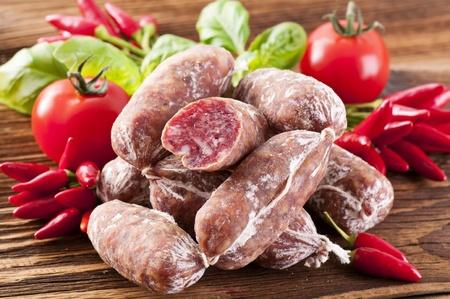 air dried salami: Air-dried salami on a wooden table
