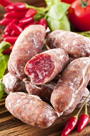 Italian air-dried salami on wooden table Stock Photo - 10577717