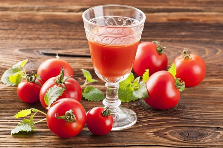 Tomati juice with fresh tomatos photo